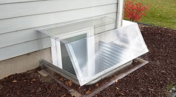 polycarbonate window well cover in atrium dome style