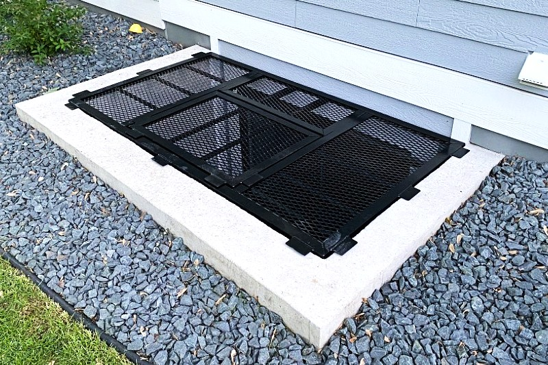 Large egress grate with an escape hatch in the middle.