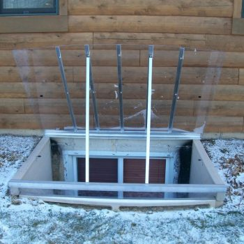 sloped crystal-clear polycarbonate cover with optional hinge and prop-up bars with extra bracing