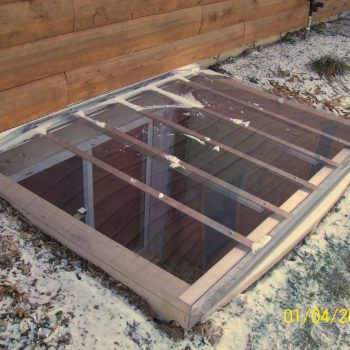 sloped polycarbonate cover made out rust free aluminium on a large sized composite well