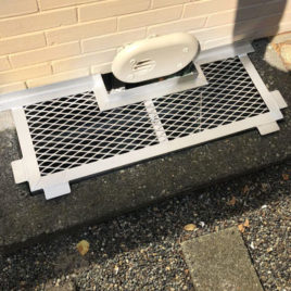 square window well grate with a special opening for electric wire switch box