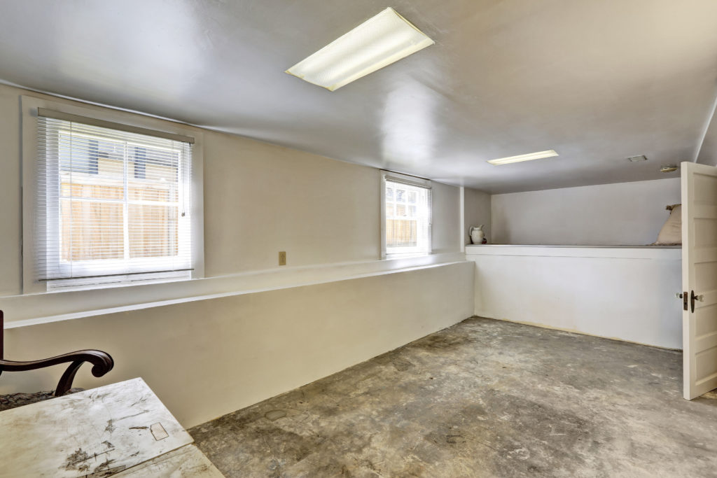 old empty basement room with concrete floor
