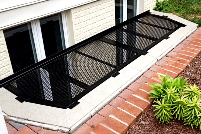 metal window well cover with irregular shape