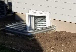 Emergency Escape Egress Kit - Window Well and a Crank-Out Basement Window That Reaches Above the Lip of the Well