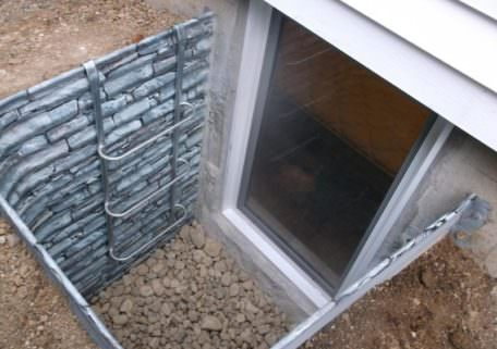 galvanized one-piece well with a faux stone finish that is part of a full egress kit