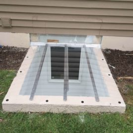 custom-made window well cover, installed on square concrete well