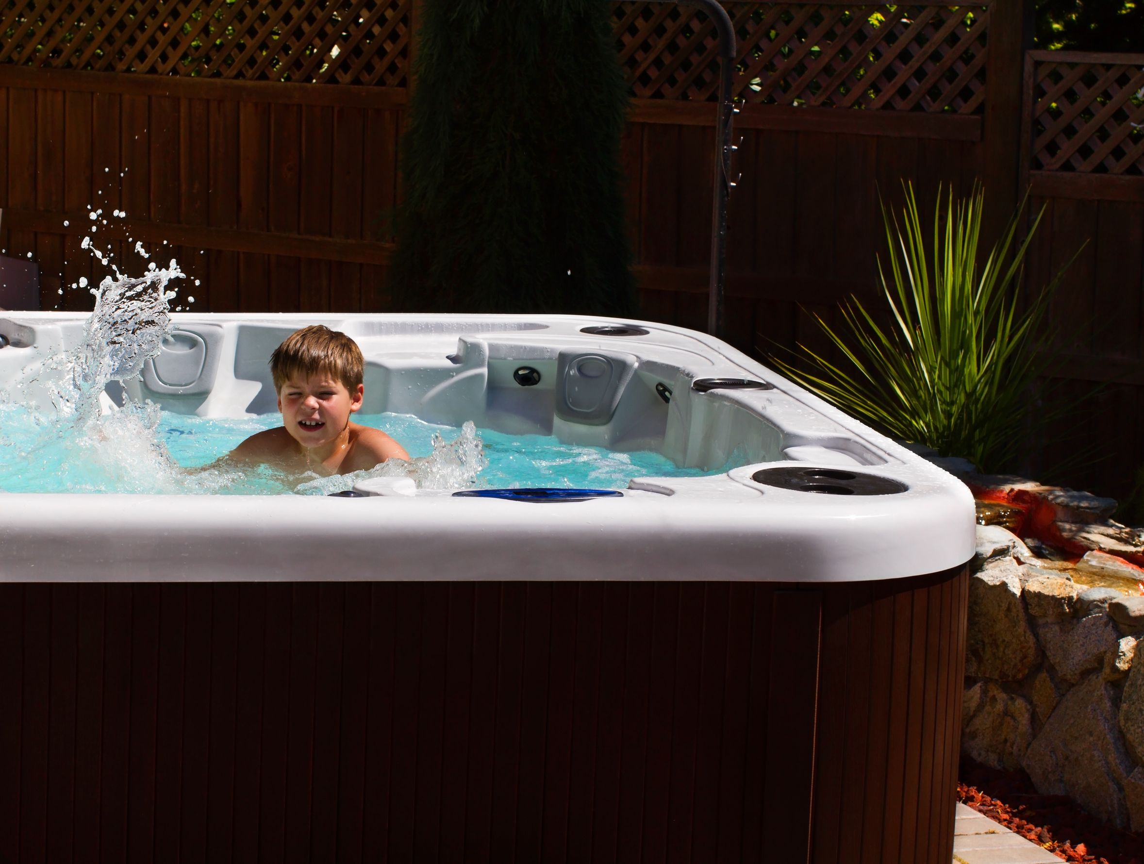 child swimming in a jacuzzi