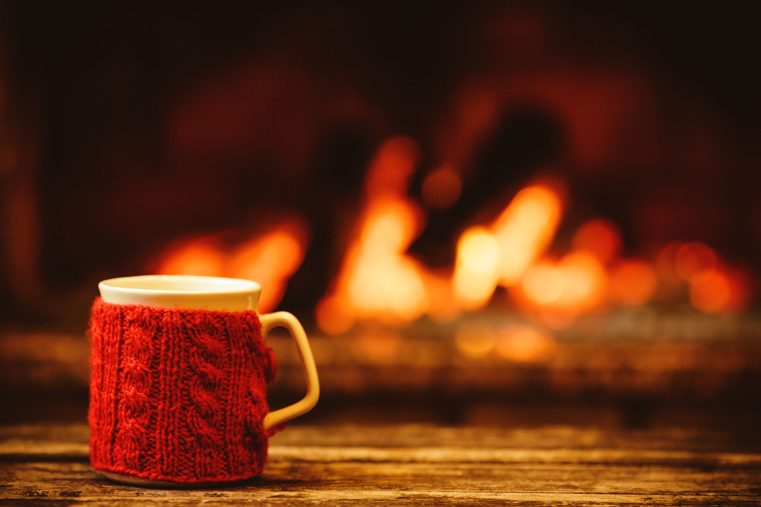 cup in front of fireplace