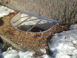 semi-circle-window-well-cover-with-snow