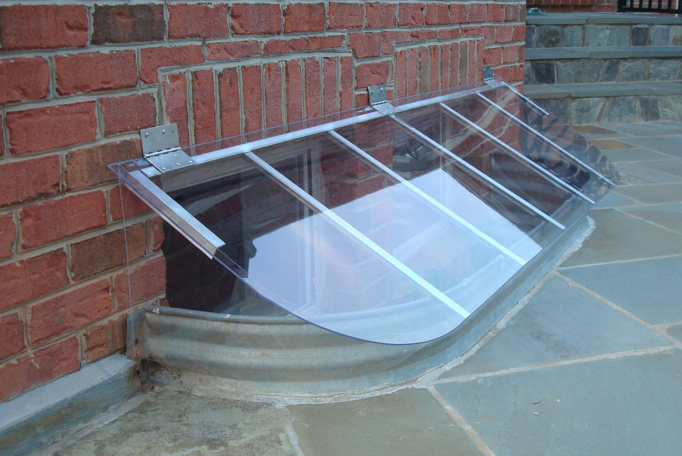 Slant Dome cover on metal window well