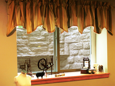 Stone finish fiberglass window well cover