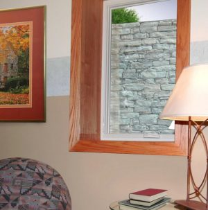 Stone Wall Metal Well As Seen From Within the Basement